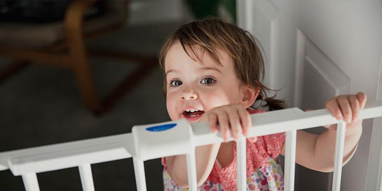 Child behind stair gate