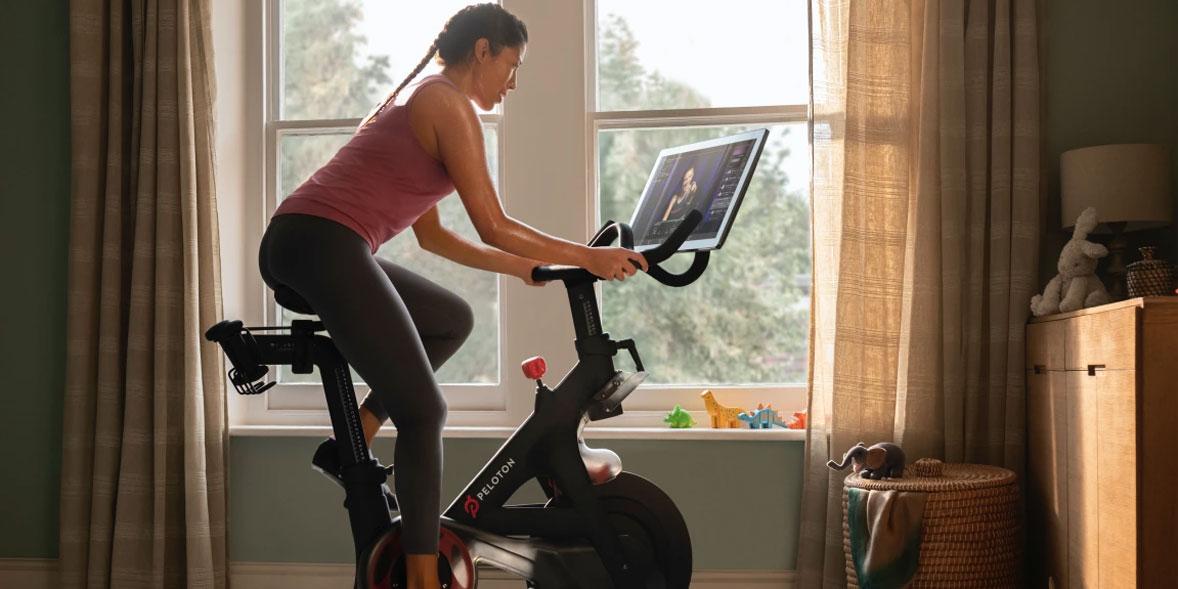 Woman on a Peloton bike