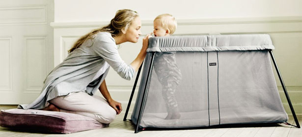 Used mum playing with baby in travel cot 436532
