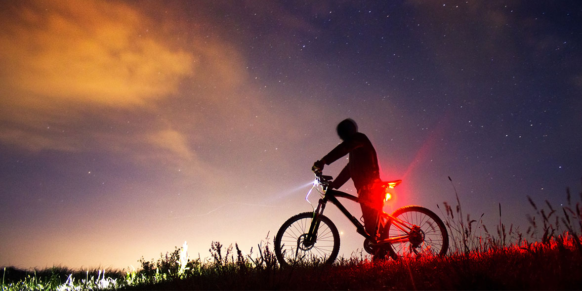 Cycling at night with front bike light and rear bike light on