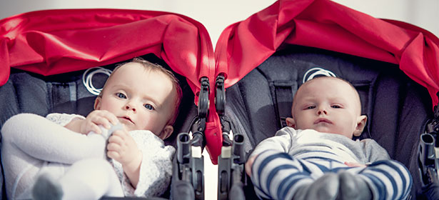 Double pushchair with babies