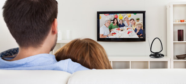 A couple watching TV with an indoor aerial