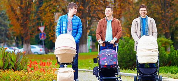 Dads pushing babies in pushchairs