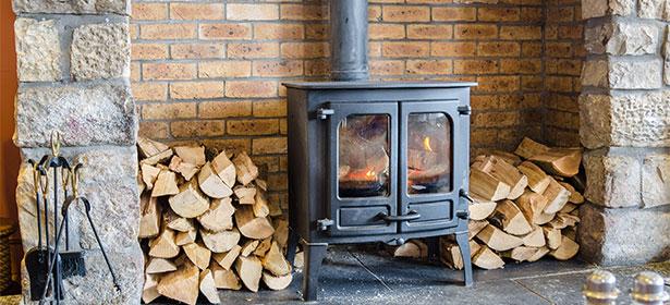 Wood burner in brick fireplace 451108