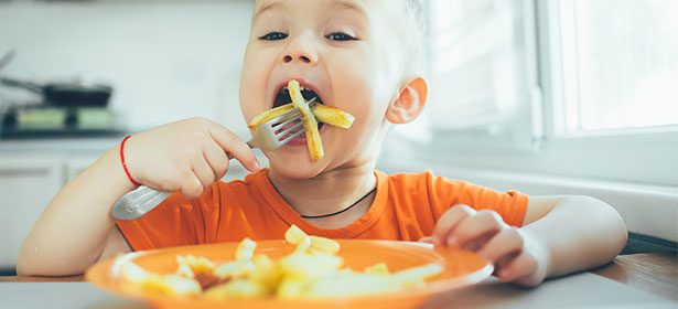 child eating oven chips