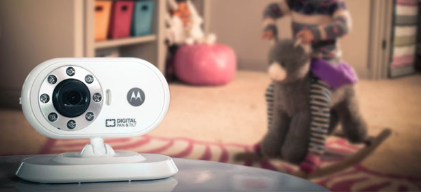 Motorola video baby monitor with child on rocking horse in background