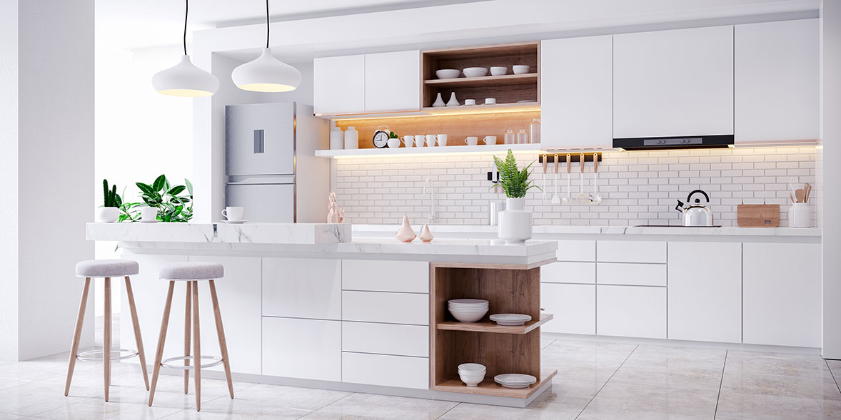 White kitchen with kitchen island and handleless doors