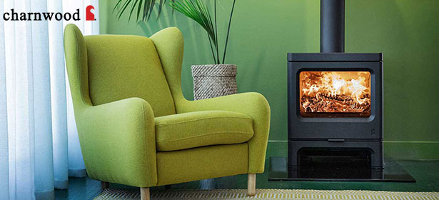 Charnwood wood burning stove next to green chair 480833
