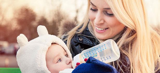 Mother bottle feeding 436690