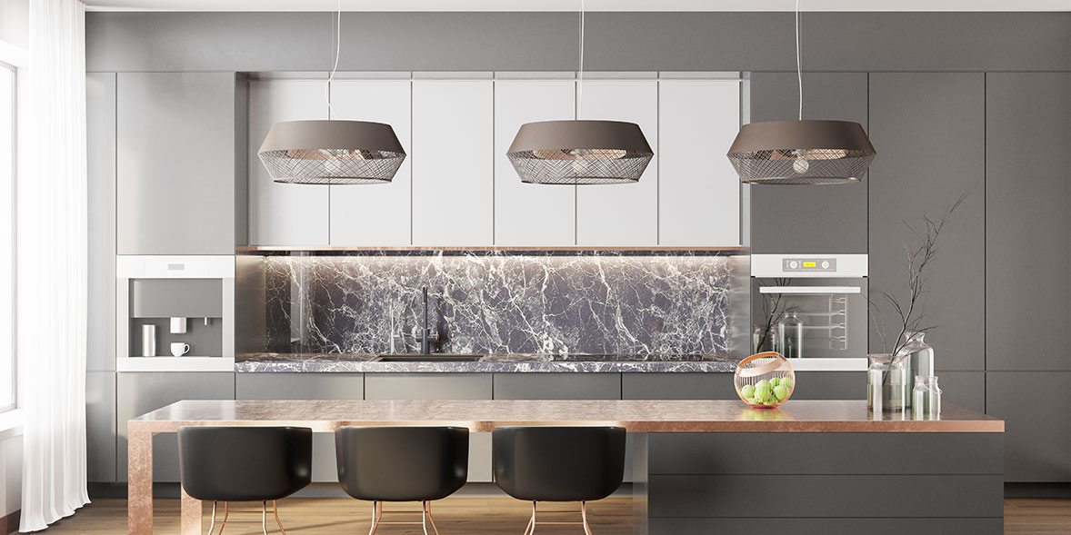 Grey kitchen with a marble effect splashback, black and wood kitchen island and three grey pendant lights