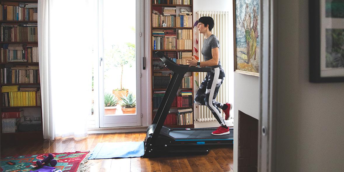 Woman using running machine