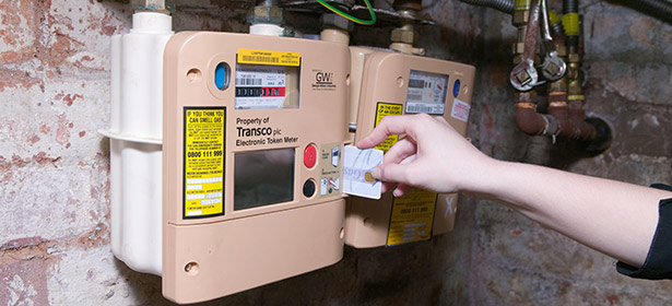 Inserting a top-up card into a prepayment meter