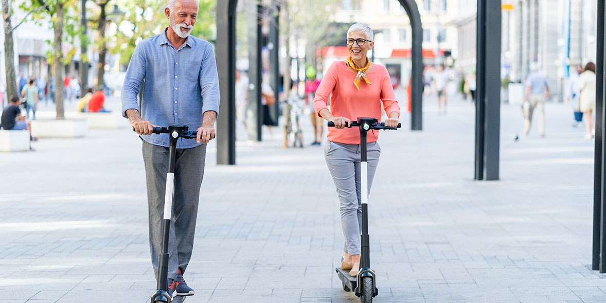 A couple riding electric scooters