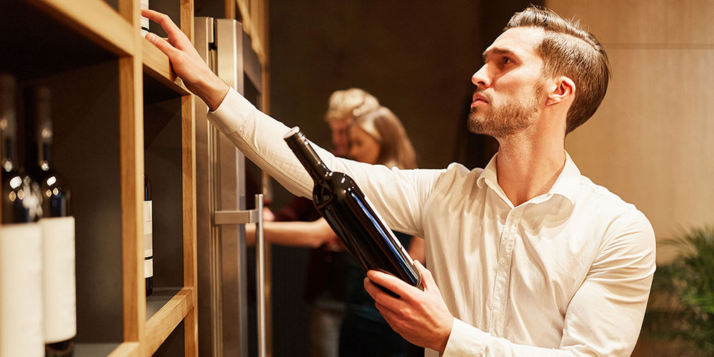Person shopping for wine