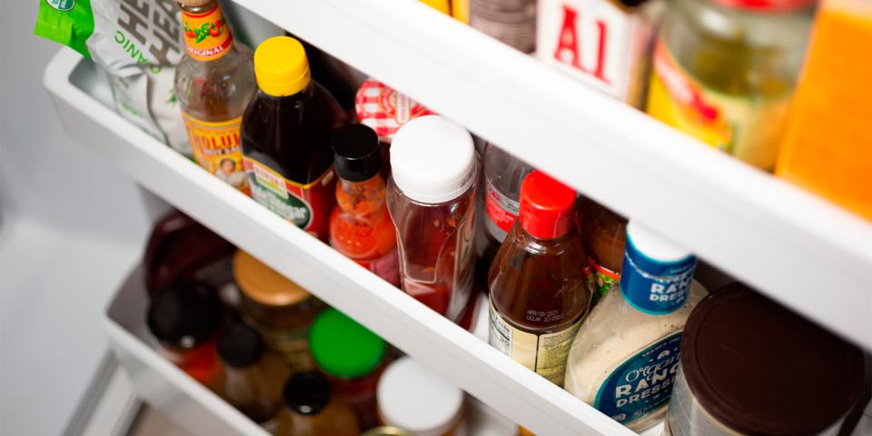 Condiments stored in a fridge door