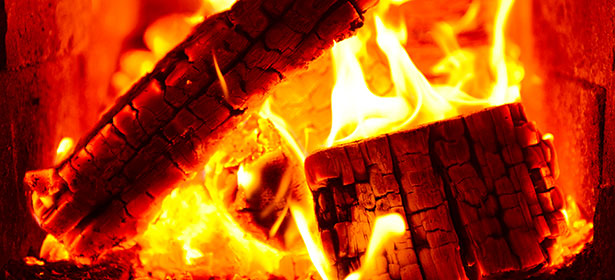 Logs on fire in a wood burning stove 470227