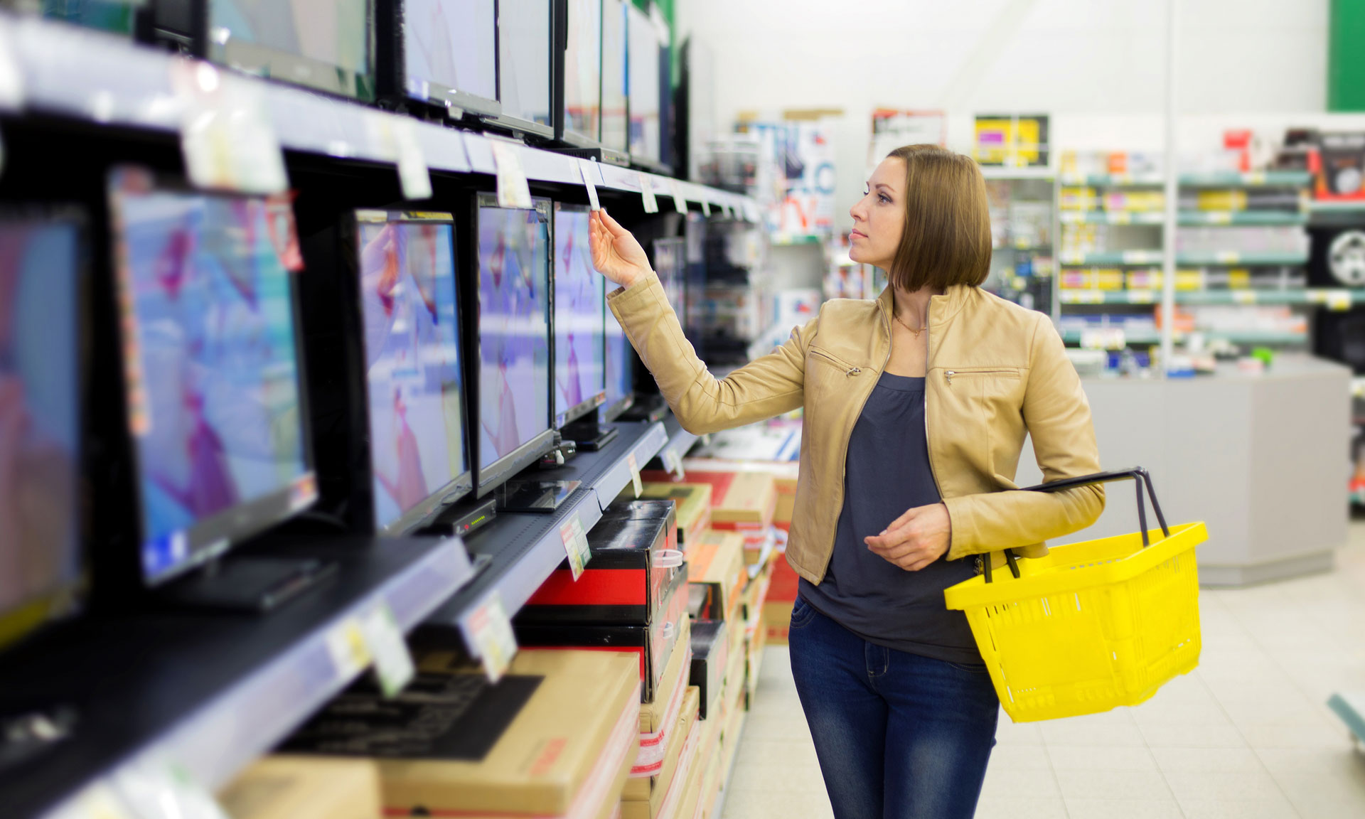 Woman buying a TV in a shop