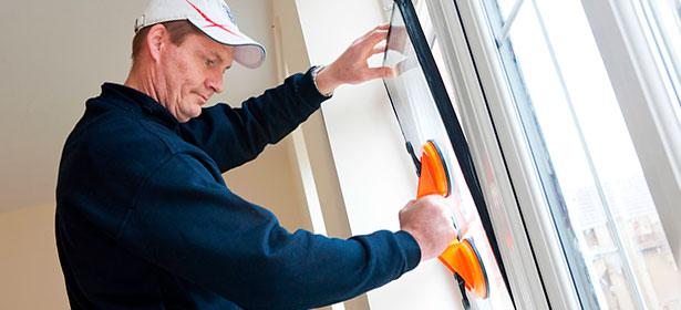 Man installing double glazing