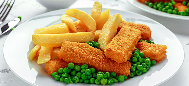 plate of oven chips, fish fingers and peas
