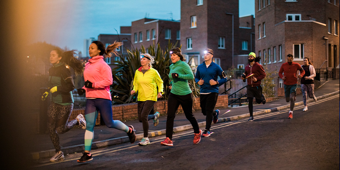 A group of joggers wearing head torches