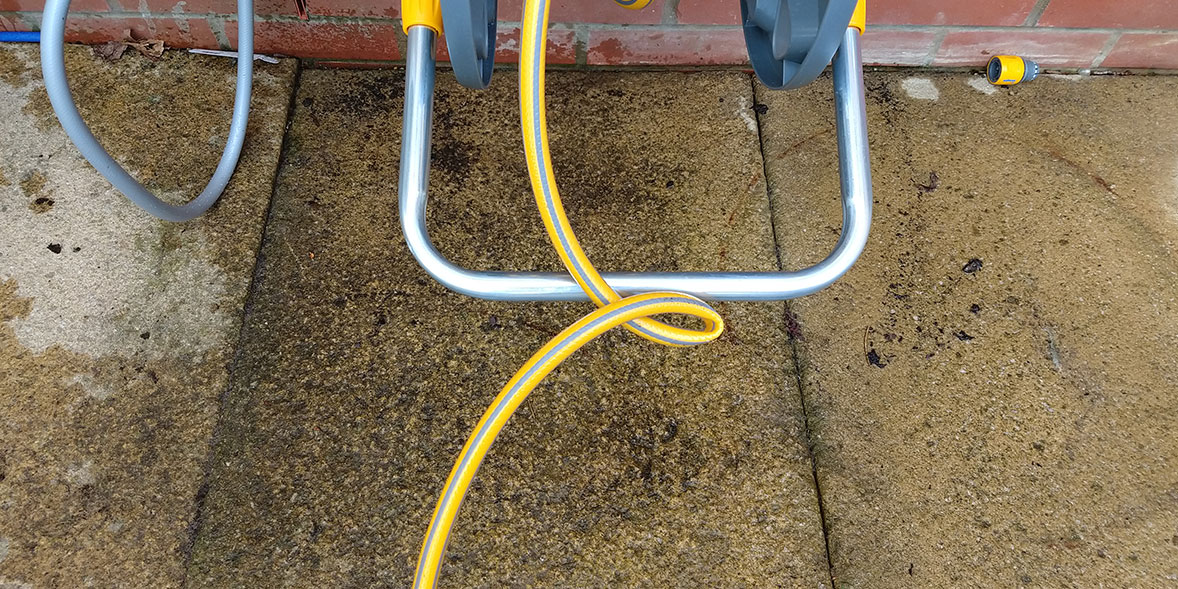 A kinked hose being reeled in