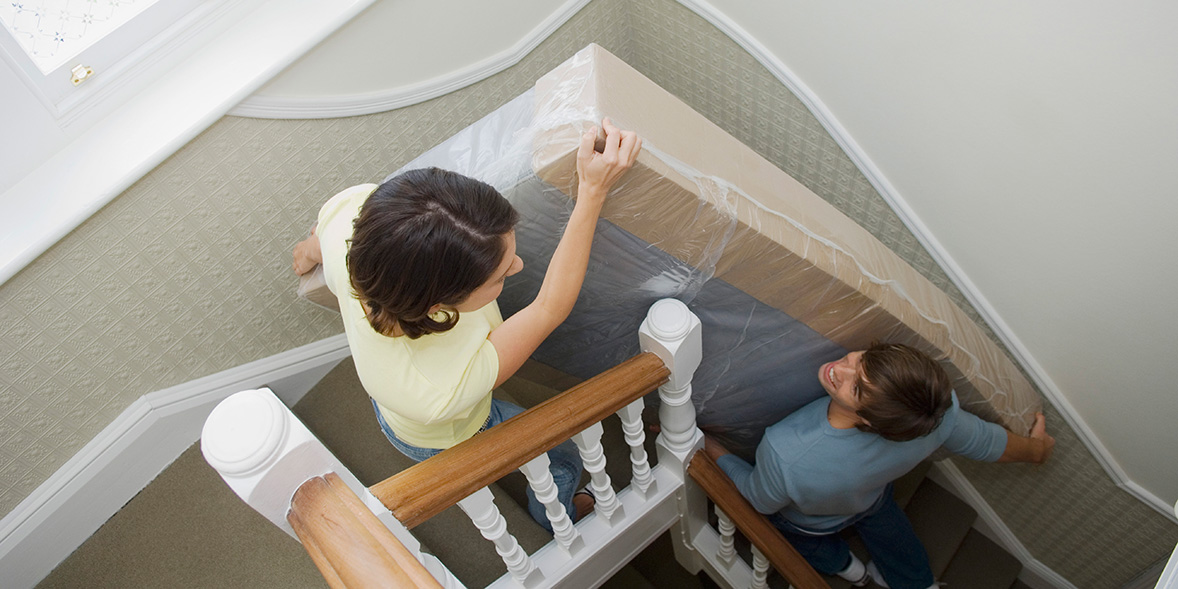 carrying a mattress up the stairs