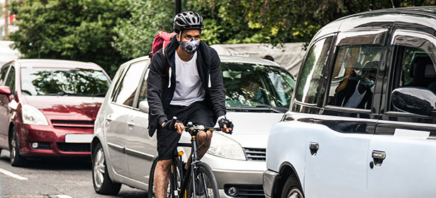 Cyclist wearing face mask