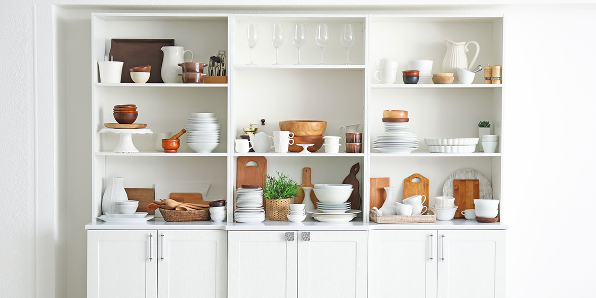 White freestanding kitchen shelving and cupboard units
