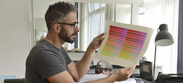 Man looking at colour print