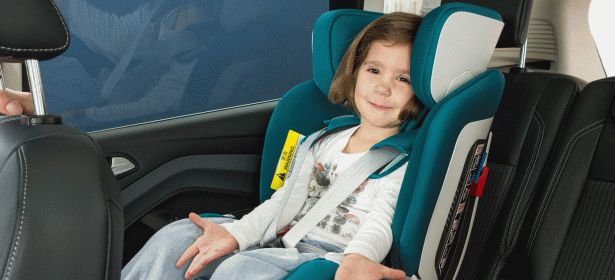 little girl strapped into car seat