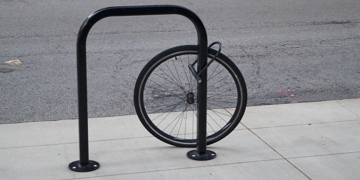 Bike stand with tyre locked to it