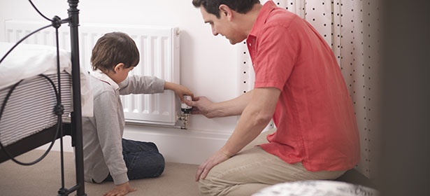 Father and son checking radiator_main 386084