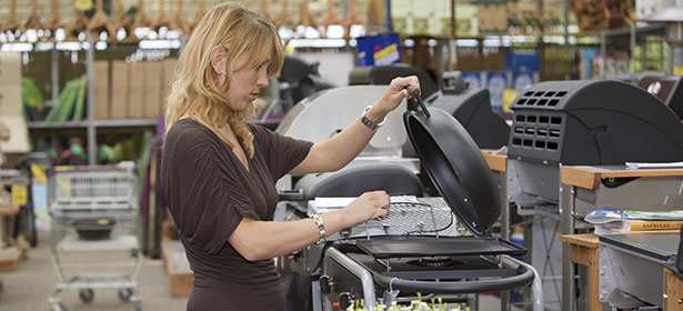 Woman shopping for a new barbecue