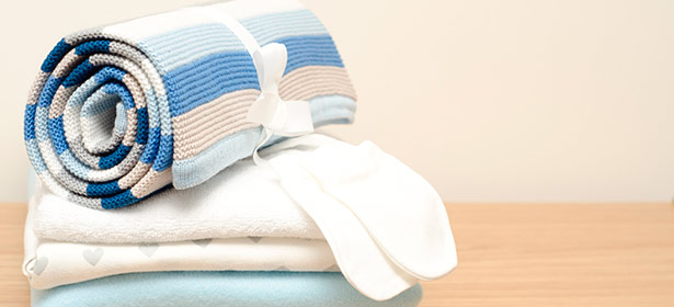 Array of baby bedding and towels