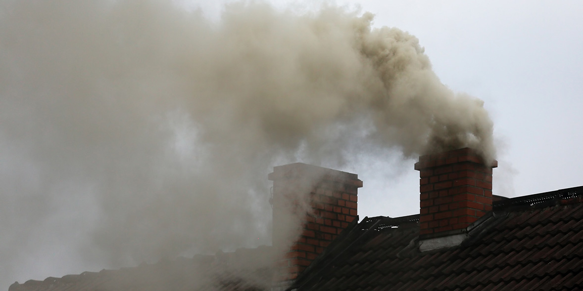 Chimney with smoke coming out of it