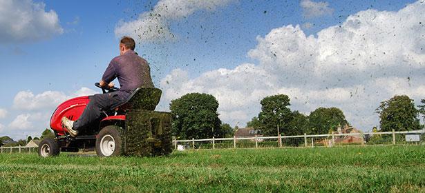 Man cutting grass on a ride-on lawn mower