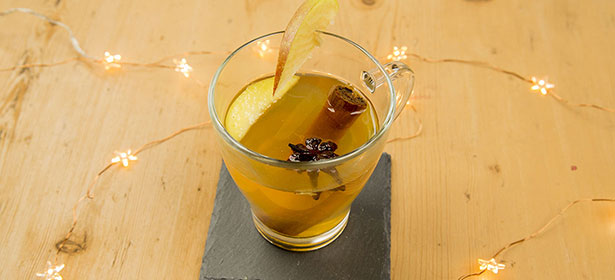 Glass of slow cooker mulled cider