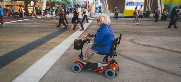 Woman on a mobility scooter at an exhibition 429439