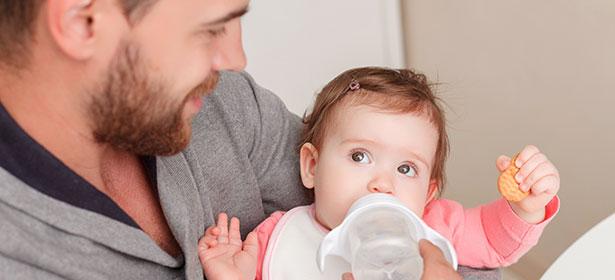 Dad feeding baby 436688