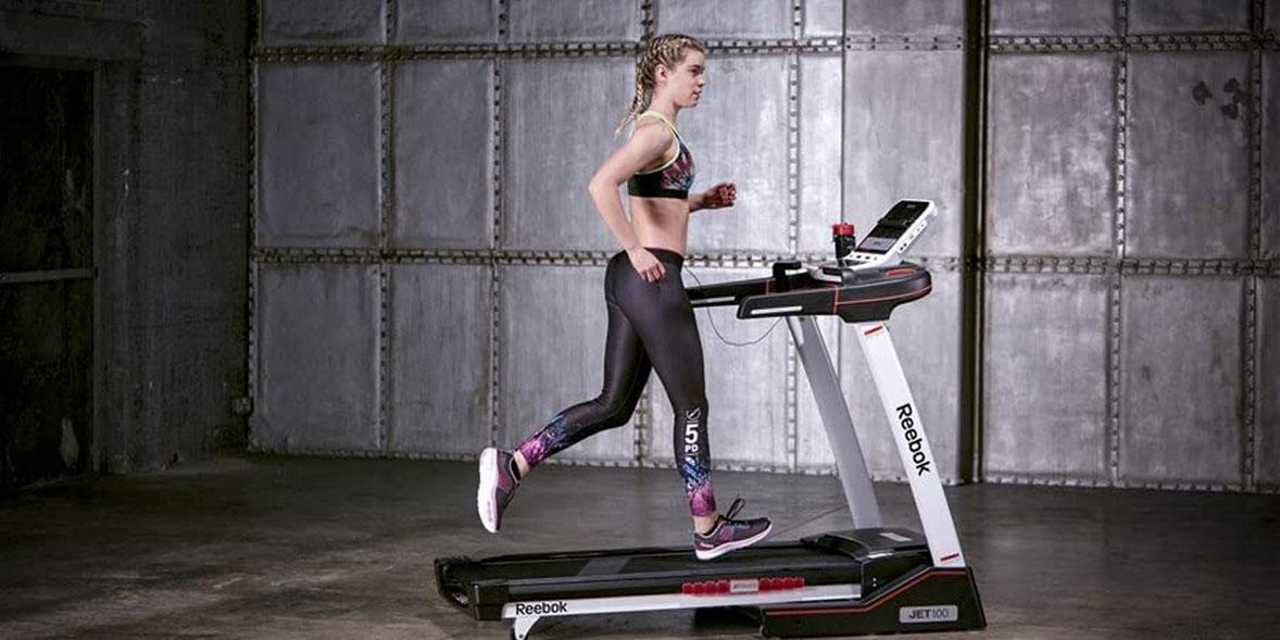 Woman running on a Reebok treadmill
