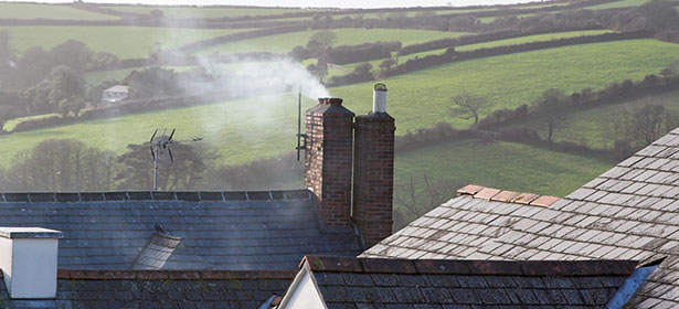 Chimney smoke from a wood burning stove 472173