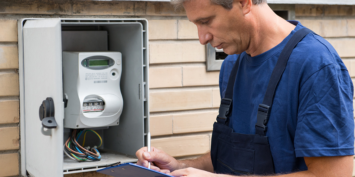 Engineer checking a smart meter