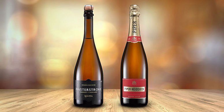 Bottle of champagne next to bottle of sparkling wine
