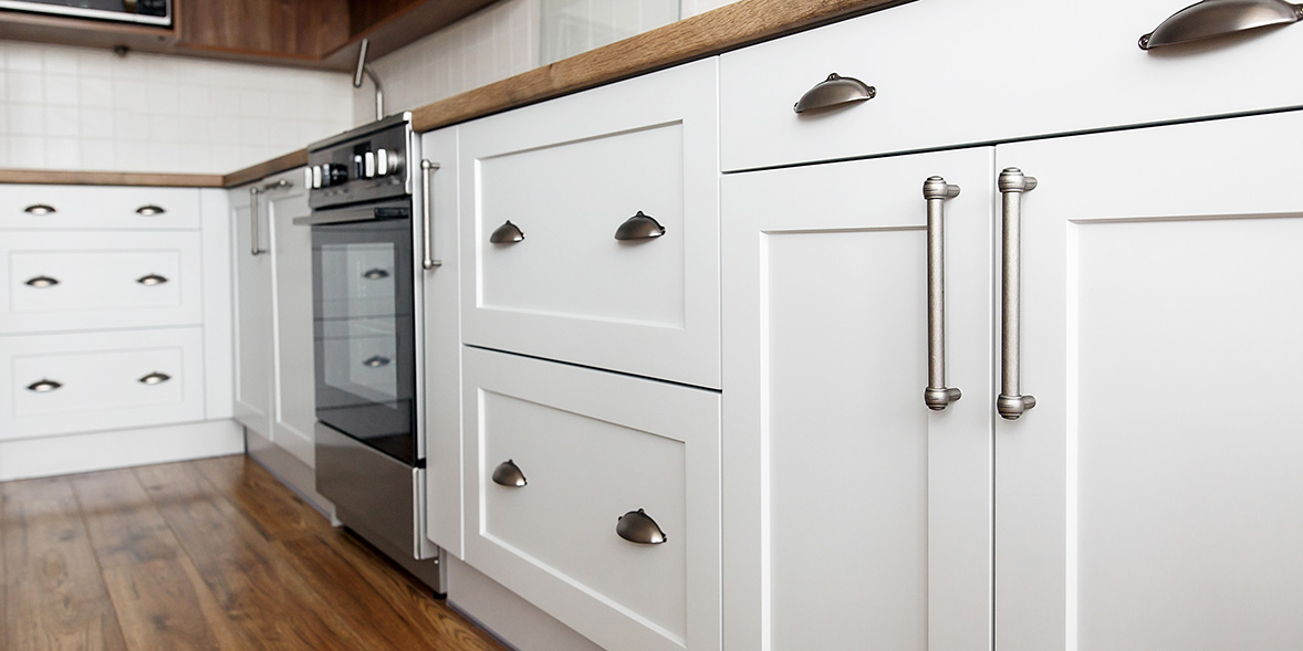 White kitchen cabinets with silver cupboard handles