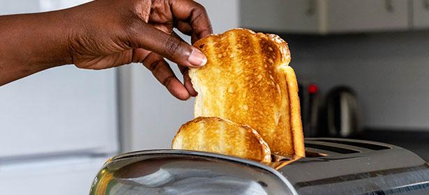 Hand-removing-toast