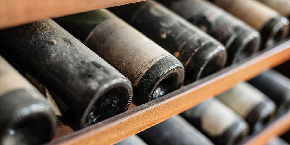 Dusty bottles of wine on a wine rack