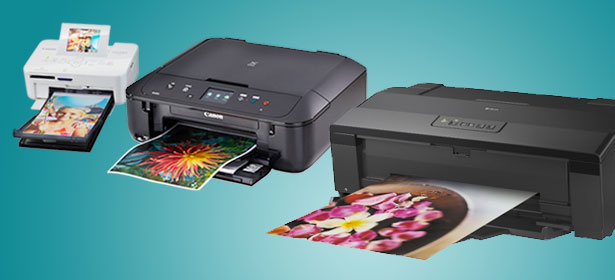 A small photo printer, an A4 printer, and an A3 printer side by side