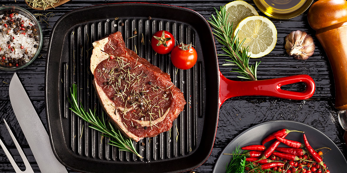 Steak cooking on a griddle pan