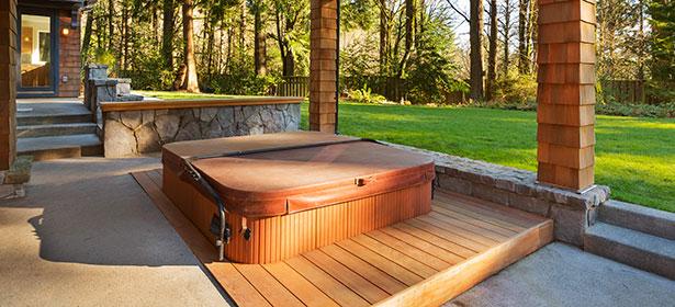 in-ground hot tub in a garden