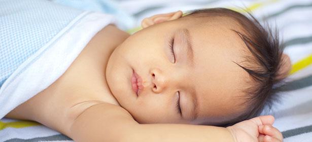 Baby boy sleeping with blanket
